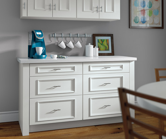 White Atwater cabinets with built-in K-Cup storage