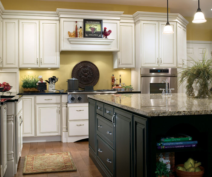 Off white kitchen with black island cabinets by Decora Cabinetry