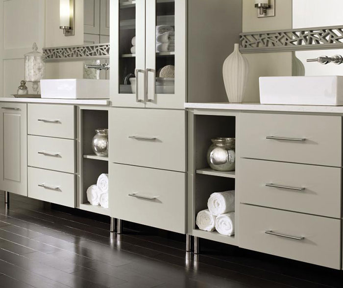 Gray cabinets in a casual bathroom by Decora Cabinetry
