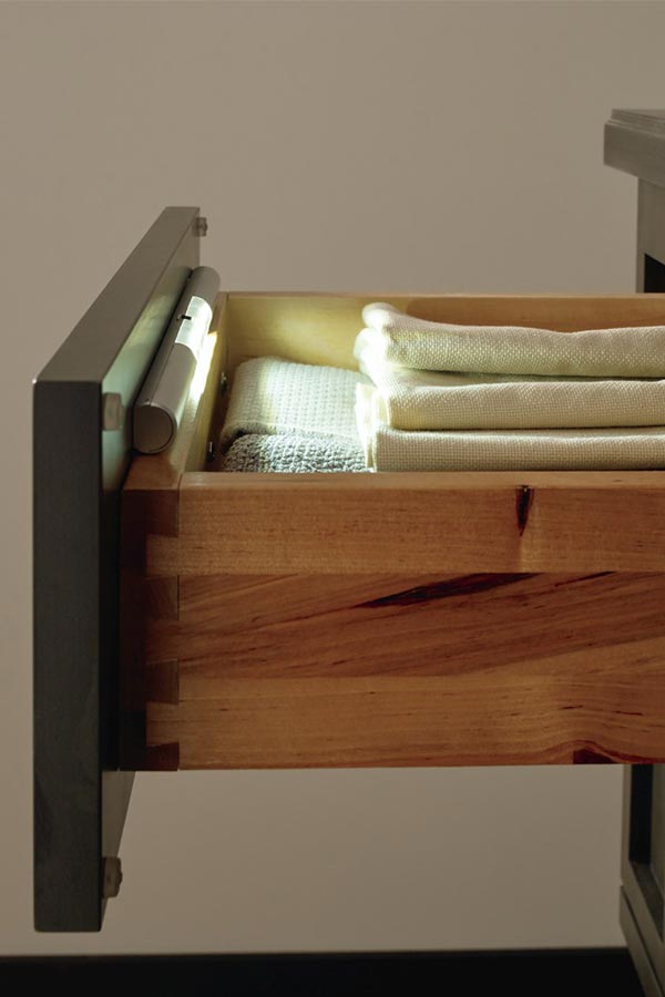 Cabinet drawer open to show battery powered light inside